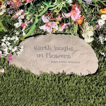 Earth Laughs in Flowers Garden Stone